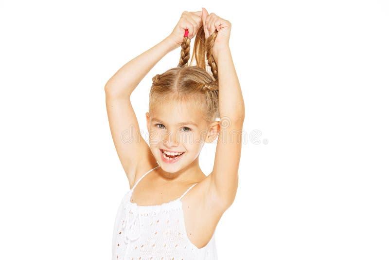 Rolig liten flicka med pigtails arkivbild