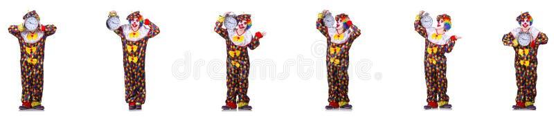 Rolig manlig clown med v?ckarklockan arkivfoton