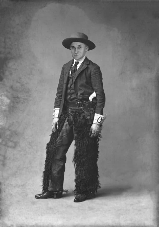 Rolig tappningcowboy, dräkt, vapen royaltyfria bilder
