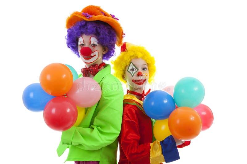 Roliga clowner med ballonger royaltyfria foton