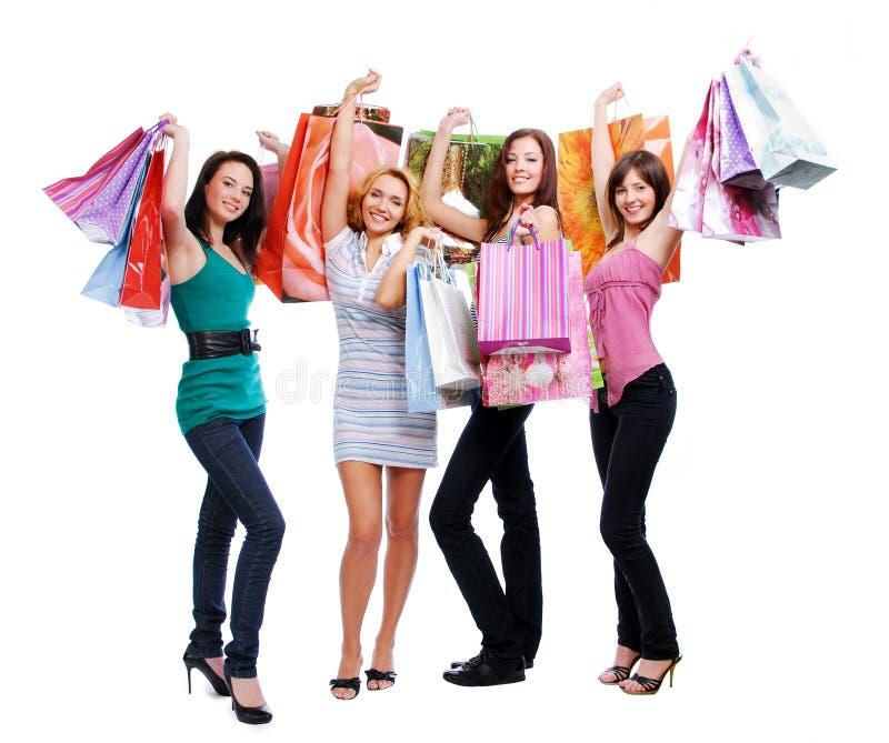 roliga flickor för skönhet som shoppar ut fotografering för bildbyråer
