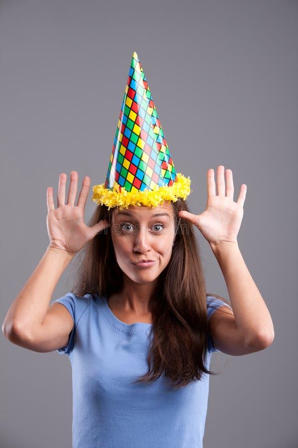 Roliga framsidor och pointy hatt royaltyfri fotografi