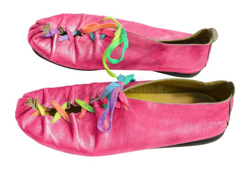 Roliga rosa färgskor för damer arkivbild