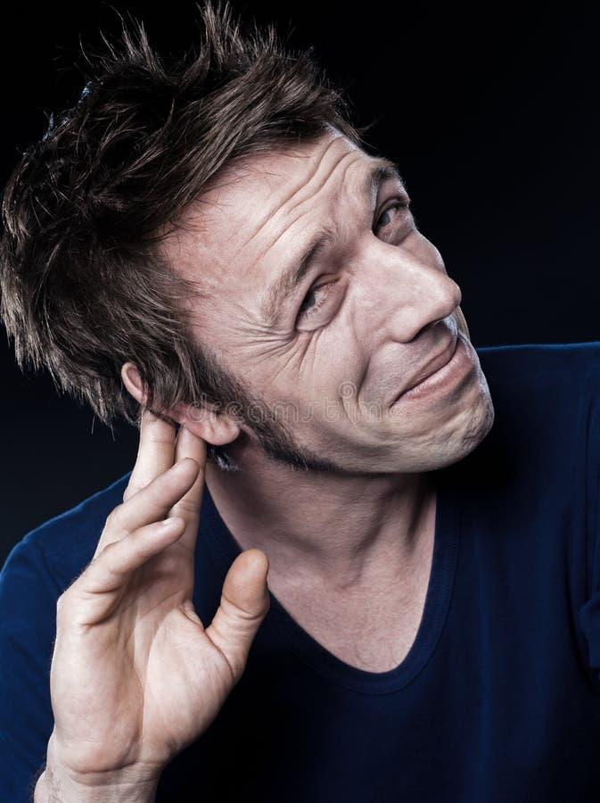roligt problem för hearingmanstående royaltyfria foton