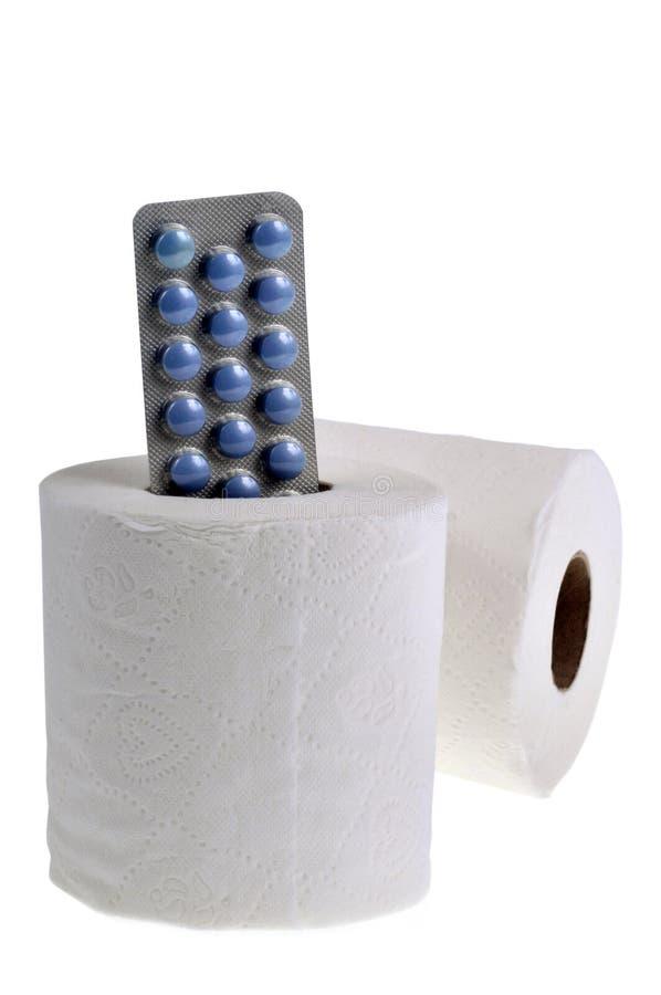 Rolka papieru toaletowego i laxative opłatek obraz stock