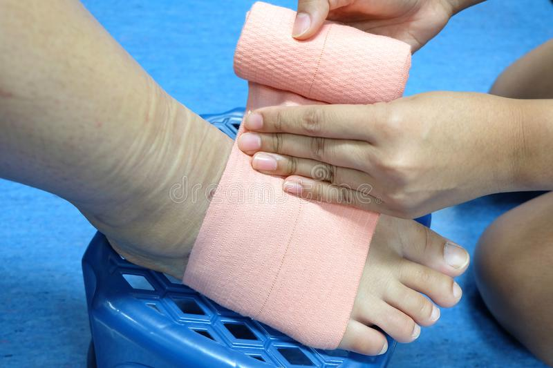 Roll a bandage for protect foot. Wrap foot bandage stock photography