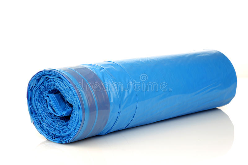 Roll of blue garbage bags. On a white background royalty free stock image
