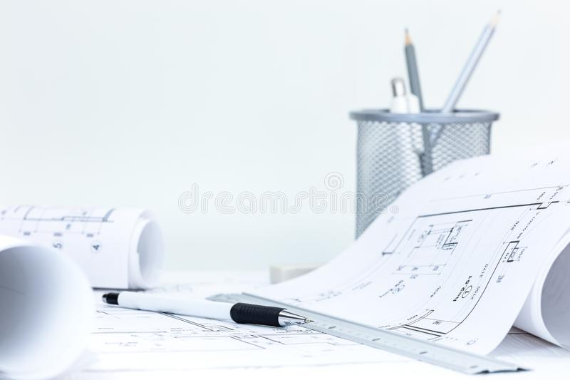roll blueprints with technical plans, engineering tools on architect workplace desk royalty free stock photo