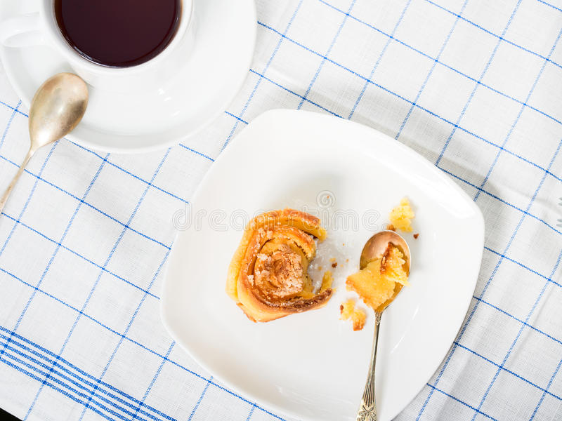 Download Roll Bun On Checkered Table Cloth With Tea Stock Image - Image: 83718229