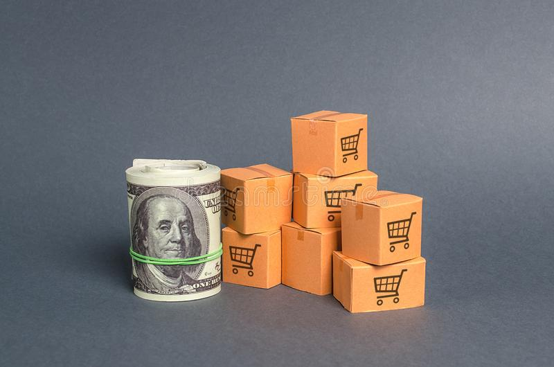 Roll bundle of dollars and cardboard boxes. International trade and trading balance. Global market and business, import and export. Of goods and services. Fees royalty free stock photography