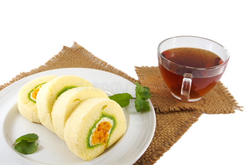 Roll cake thai dessert and tea cup royalty free stock photography