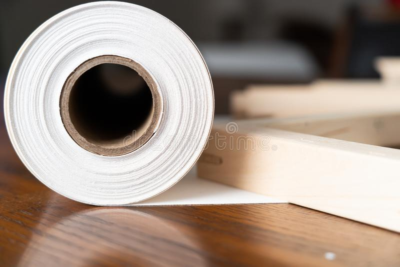 Roll of Canvas with Stretcher frames for print and framing photographs ont Canvas. Large format print royalty free stock photos