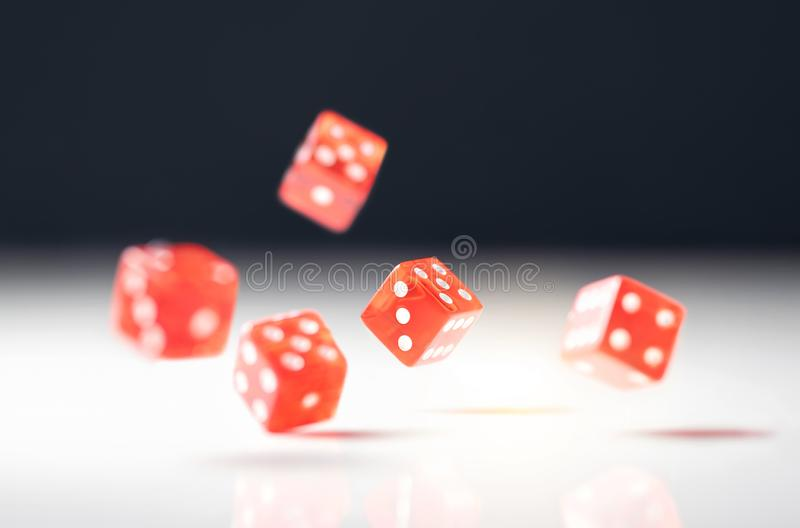 Roll the dice. Risk, luck, gambling, betting or addiction concept. Throwing five red casino and poker dice on table. royalty free stock photos
