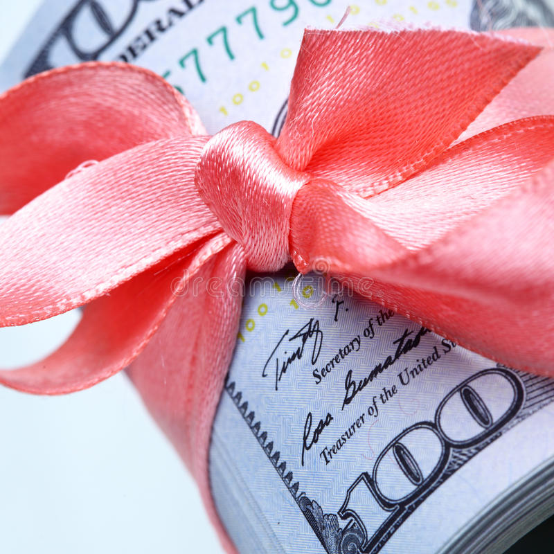 Roll of dollars. With ribbon and bow stock images