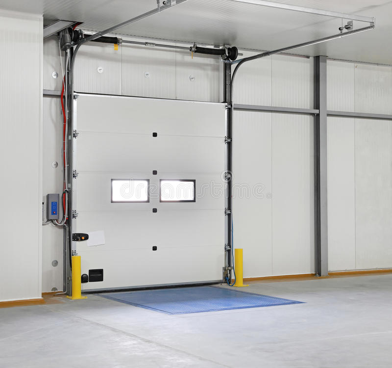 Roll doors. Closed roll door in distribution warehouse stock photos
