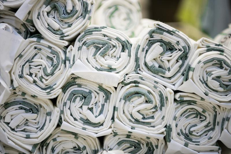 Roll the fabric folded beautifully in the textile shop. royalty free stock photography