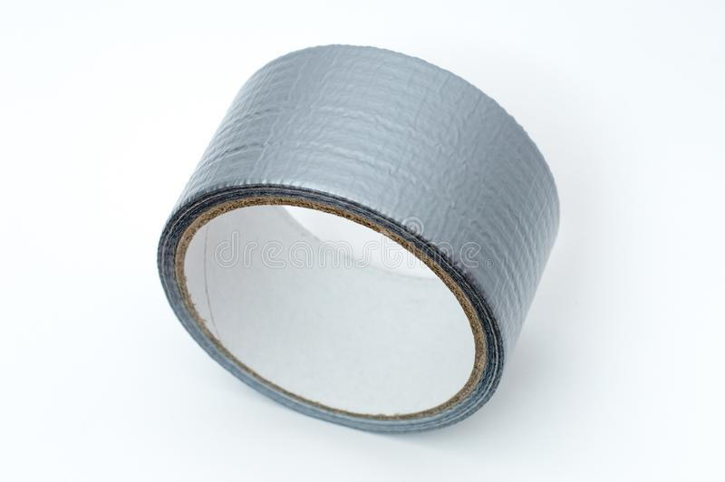 Roll of grey duct tape. stock photos