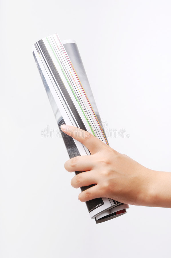 Roll of magazine stock images