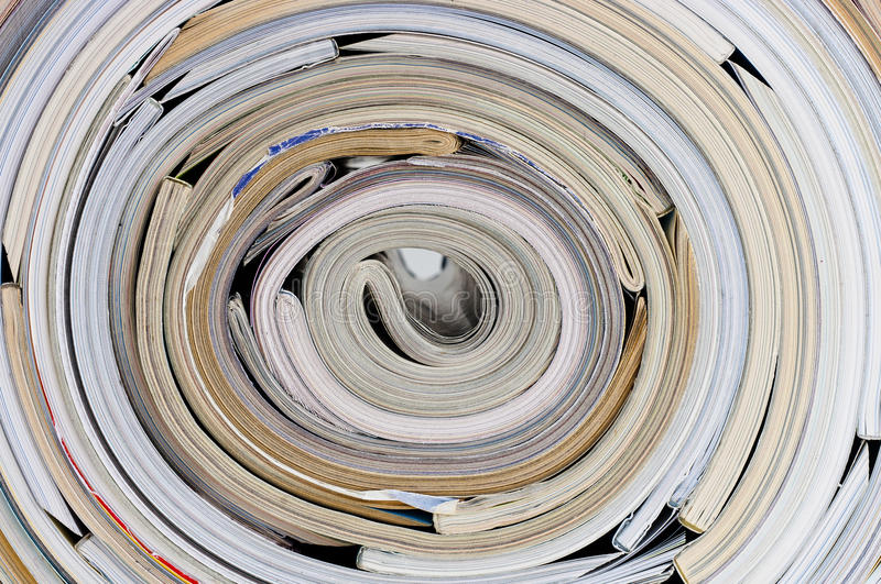 Roll of magazines stock images