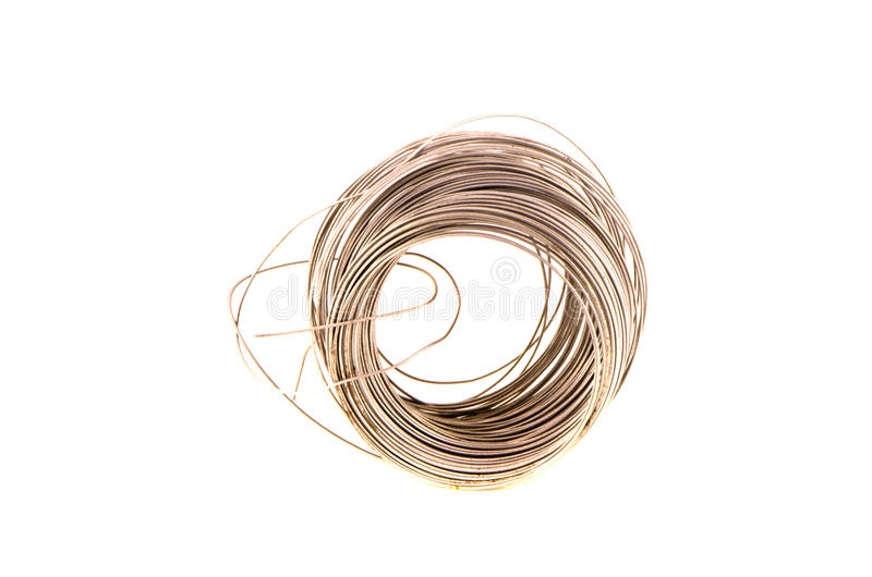 Roll of metal wire isolated on white. New roll of metal wire isolated on white background stock photo