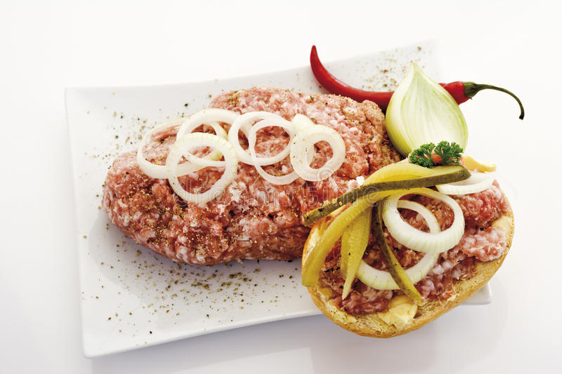 Roll with minced meat and onions stock photo