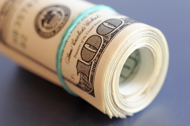 Roll of money stock images