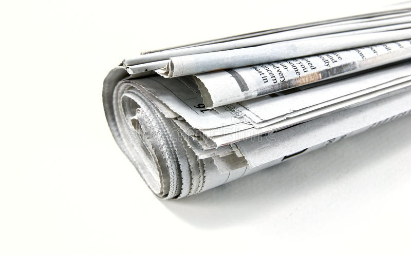 Roll of Newspaper. Shot on white background royalty free stock image