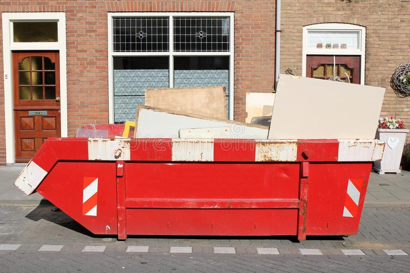 Roll-off dumpster. Filled with building rubble stock photo