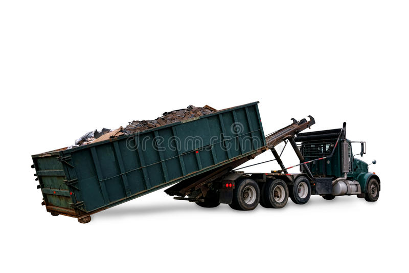 Roll Off Truck Loading Trash Container Dumpster. Roll off utility truck loading a refuse garbage dumpster open top container full of construction trash for waste stock images