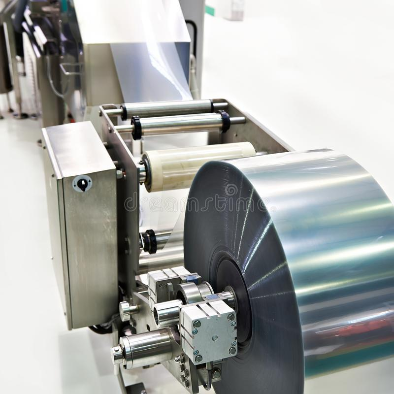 Roll of packaging film on machine food factory royalty free stock photography