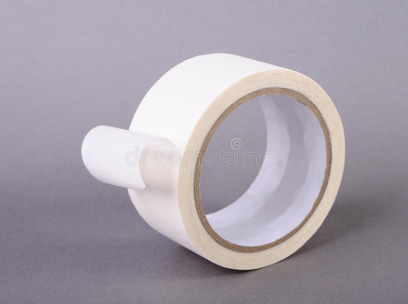 Roll of paper adhesive tape. On gray background royalty free stock images