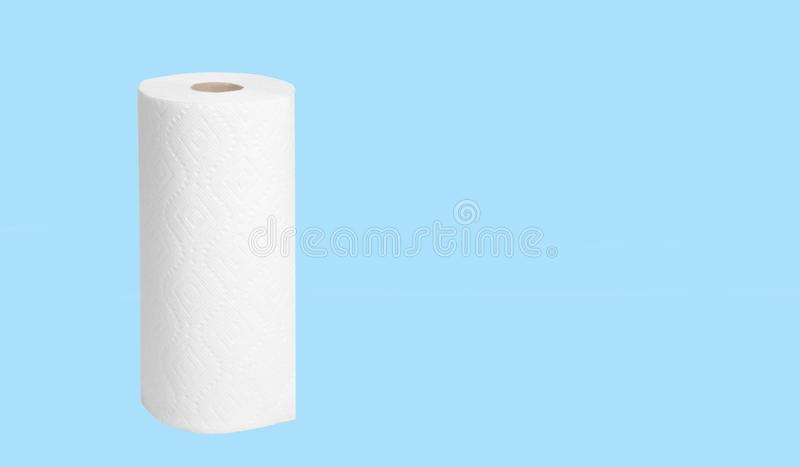 Paper towel roll on pastel blue background. Roll of paper towel for housework on pastel blue background stock photos