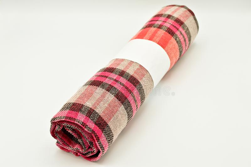 Roll pink and white plaid fabric royalty free stock image