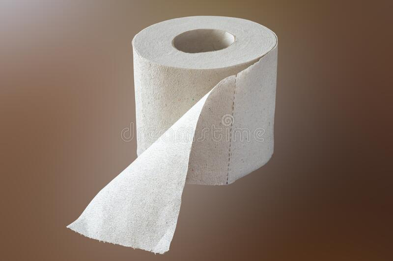 Roll of plain toilet paper. Roll of simple toilet paper on a brown background stock photos