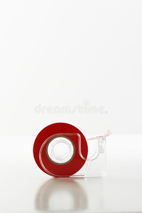 Roll Of Red Tape In Dispenser royalty free stock photography