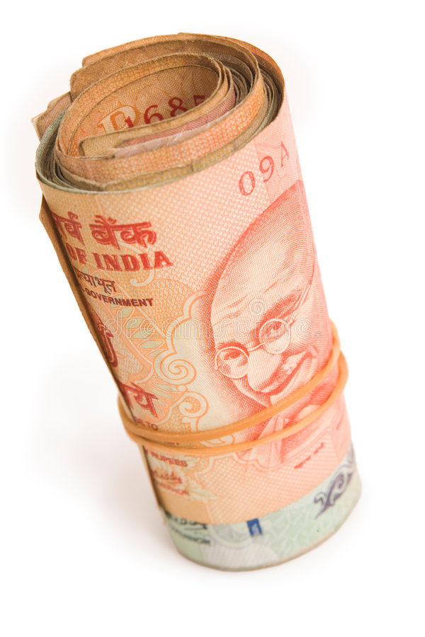 Roll of rupees. Roll of Indian Rupees isolated against a white background royalty free stock images