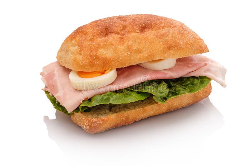 Roll sandwich with boiled ham an hard cooked egg stock photos