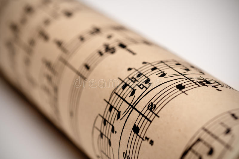 A roll of sheet music. On old discolored parchment royalty free stock photo