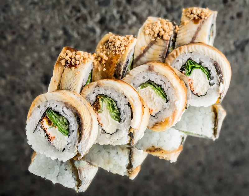 Roll with smoked eel, salad and cream cheese stock images