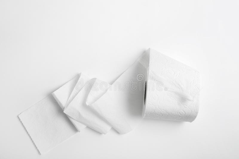 Roll of toilet paper with feather on white background royalty free stock photo