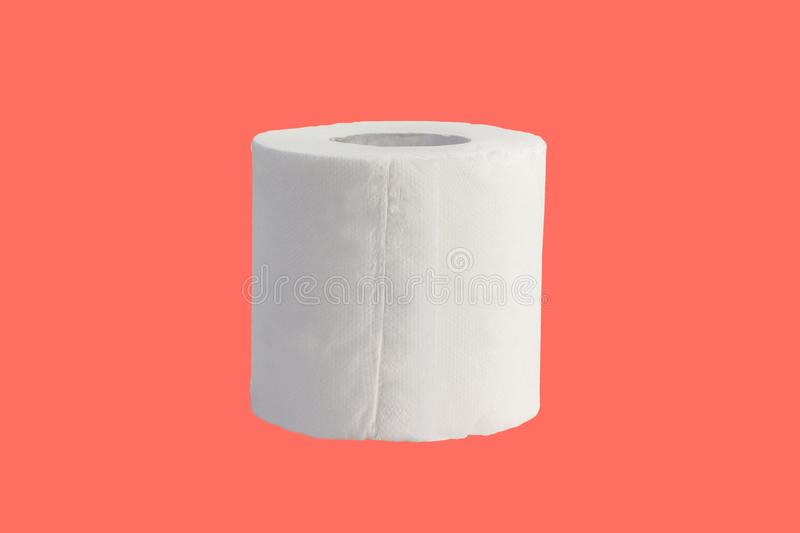 Roll of toilet paper isolated on coral background. White bathroom clean hygiene object health household recycle restroom sanitary living soft wc wipe cleaner stock images