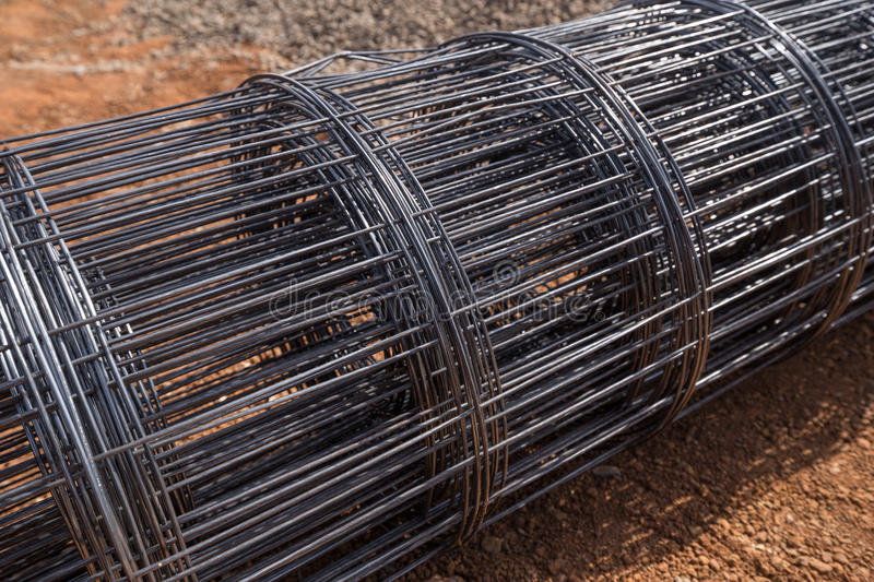 Roll of wire mesh. On construction site stock photos