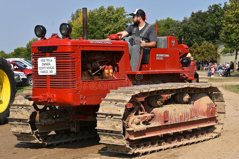 Bulldozer in a farm show parade. ROLLAG, MINNESOTA, Sept 2, 2017: An old restored International diesel bulldozer is displayed in the daily parade at the annual royalty free stock images