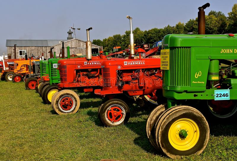 Row of restored various tractor models. ROLLAG, MINNESOTA, Sept 1, 2017: A row of various tractors models are displayed at the annual WCSTR farm show in Rollag stock image
