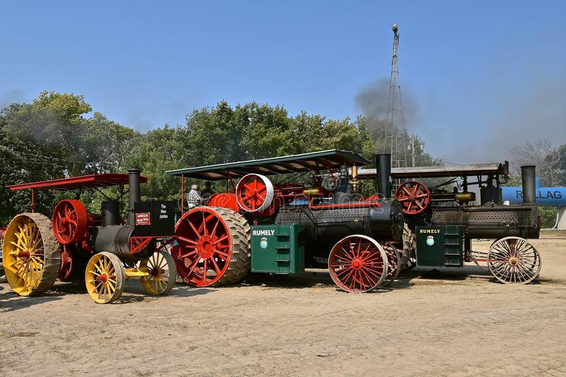 Rumel steam engines ready for a parade. ROLLAG, MINNESOTA, Sept 2, 2017: Rumely and Harrison steam engines are ready for the daily parade at the annual WCSTR royalty free stock photos