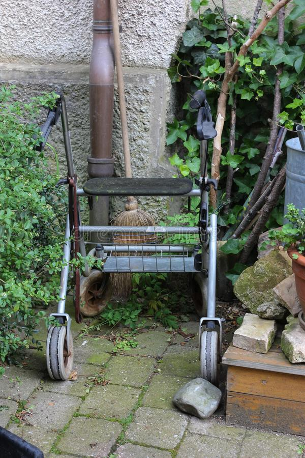 rollator of a senior lady on an old cottage entrance area stock photos
