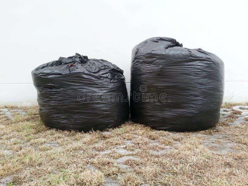 Rolle der Abfallsäcke stockbilder