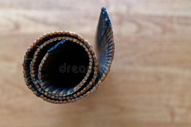 Rolled Bamboo litter on a wooden table texture stock image