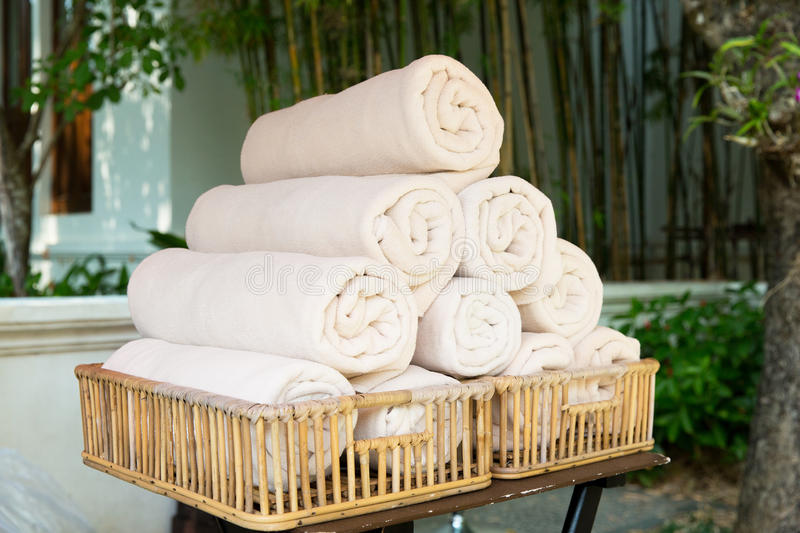 Rolled bath towels at hotel spa. Luxury and hygiene concept - rolled bath towels at hotel spa royalty free stock photo