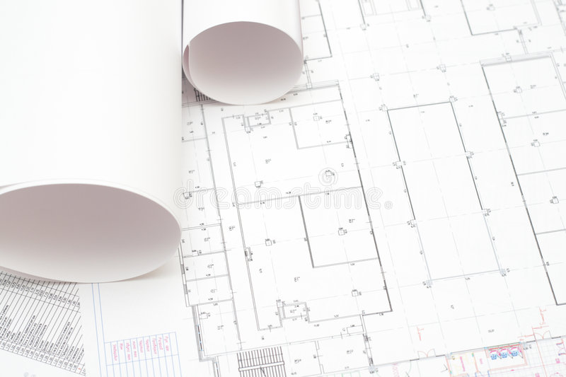 Rolled blueprints. Arhitectural construction document and plans to serve as background royalty free stock image